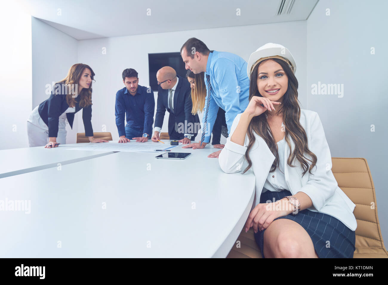 Business people group on meeting with construction engineer business people group on meeting with construction engineer architect looking building blueprint in modern office malvernweather Images