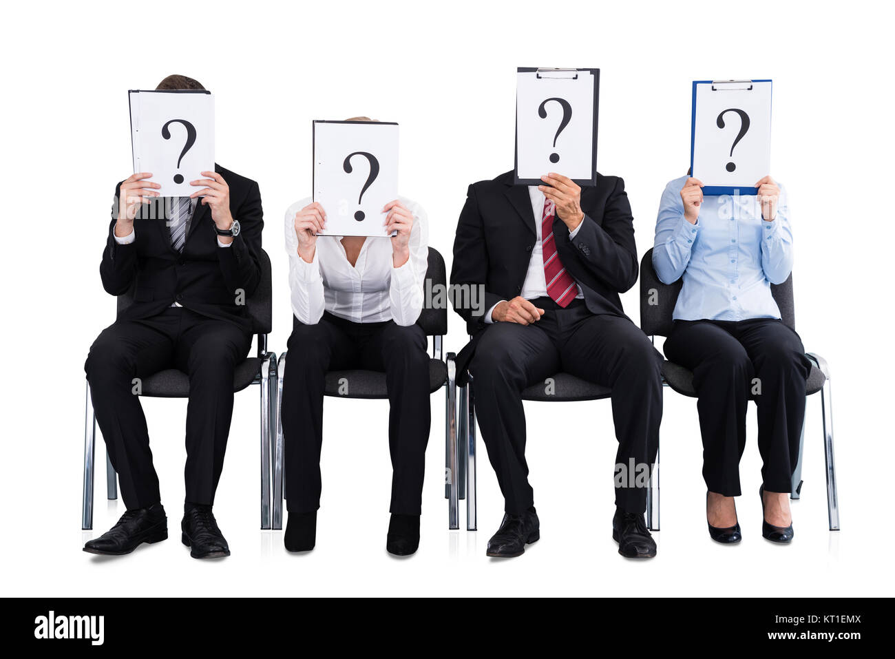 Businesspeople Holding Question Mark Sign - Stock Image