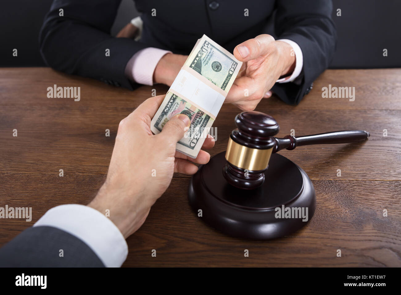 Businessman Giving A Bribe To A Judge - Stock Image