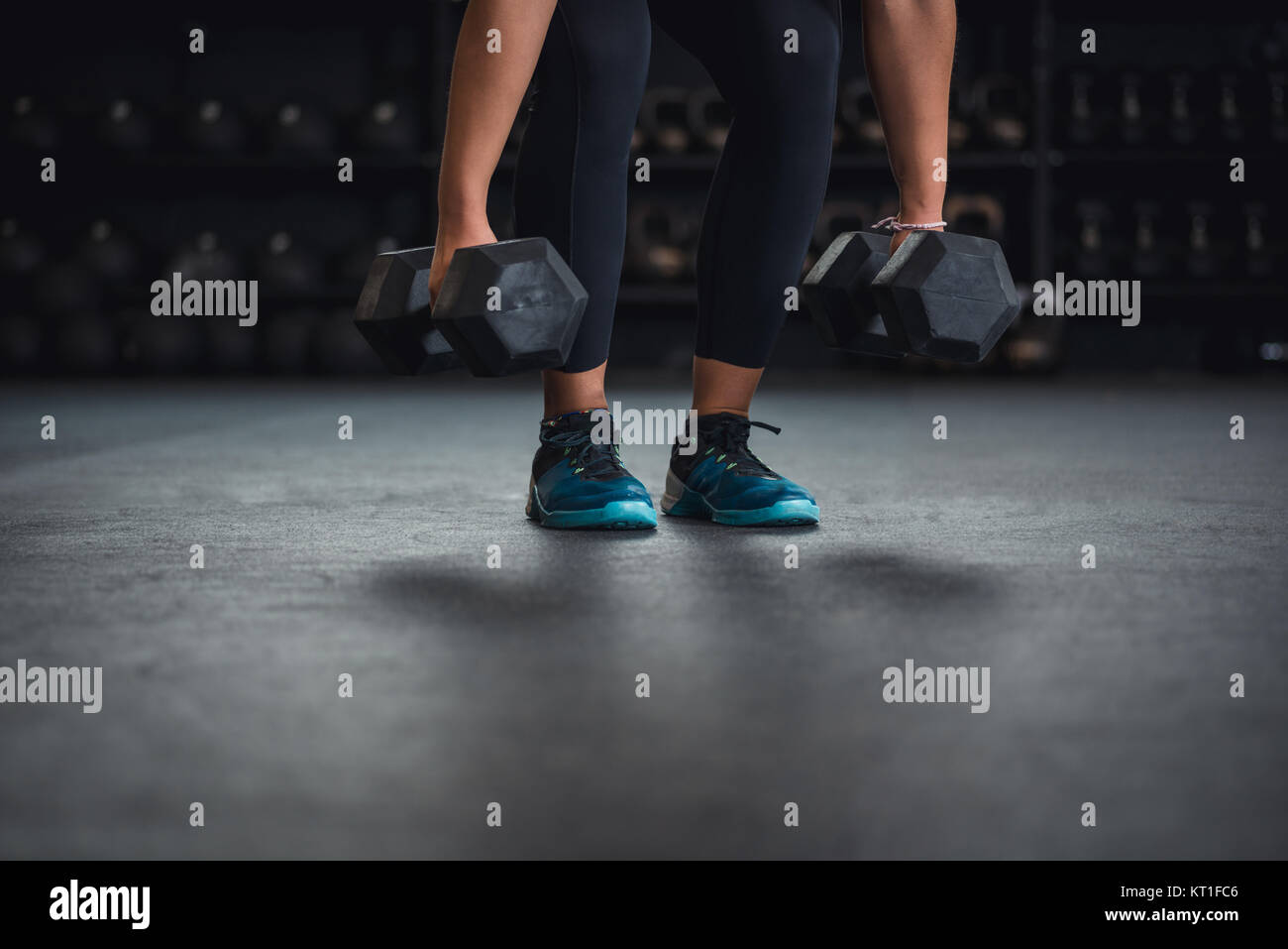 Ethnic woman working out in gym with kettlebells. - Stock Image
