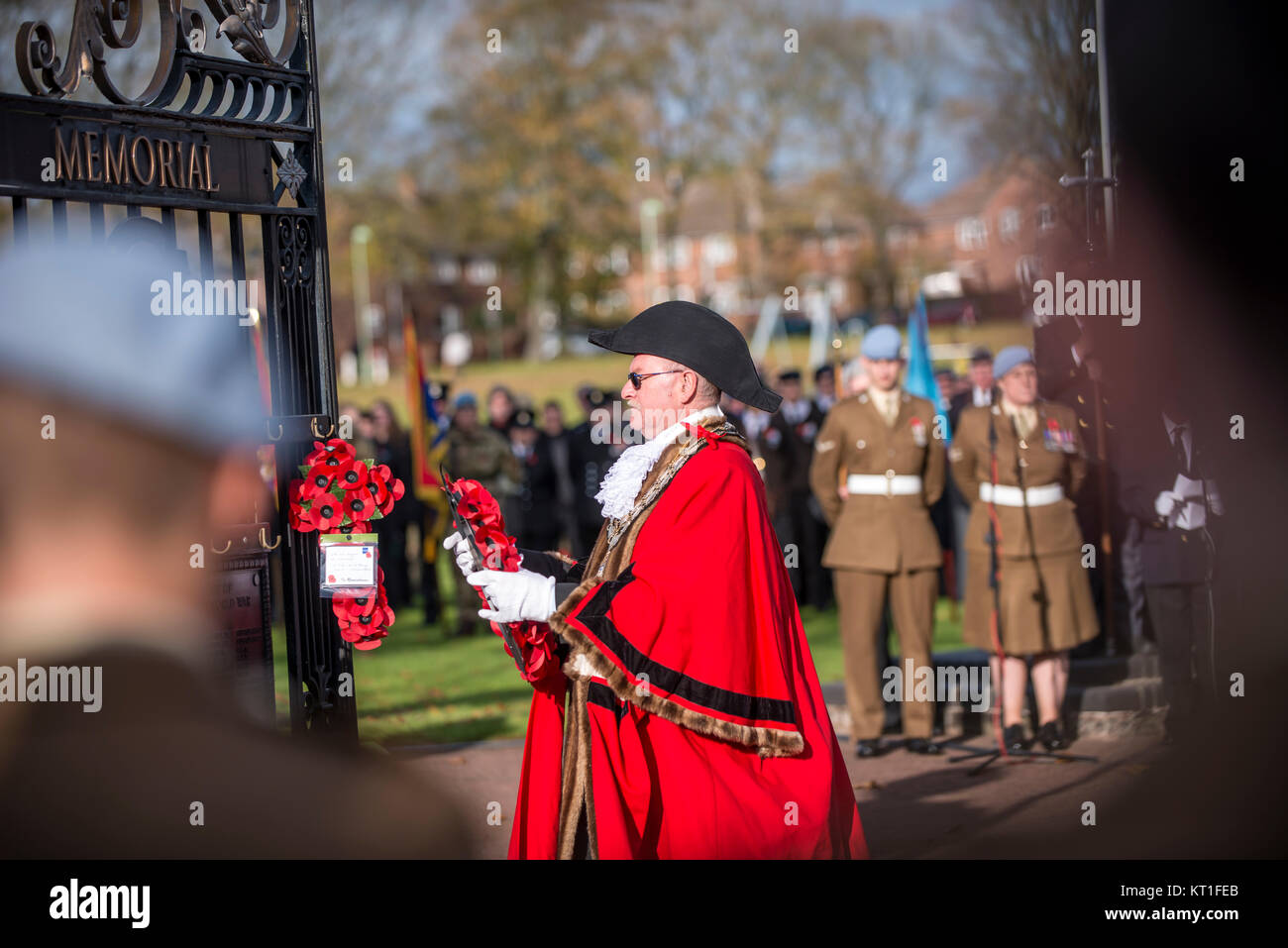 Mayor at Remembrance Day Parade In Stowmarket UK in Bright Red Ceremonial Robe about to Lay Wreath on Memorial Gate - Stock Image