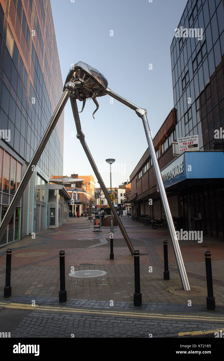 Woking, England, UK - April 13, 2014: A sculpture in the central business district of Woking depicts a Marsian fighting - Stock Image