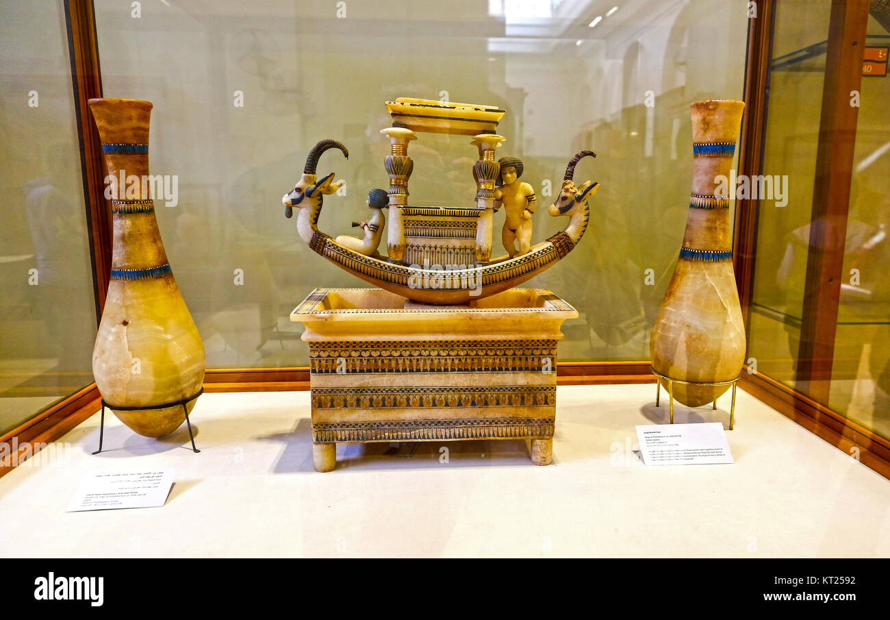 Calcite long necked vases flanking a calcite basin supporting a boat with shrine found in tomb of Tutankhamum, Egyptian - Stock Image