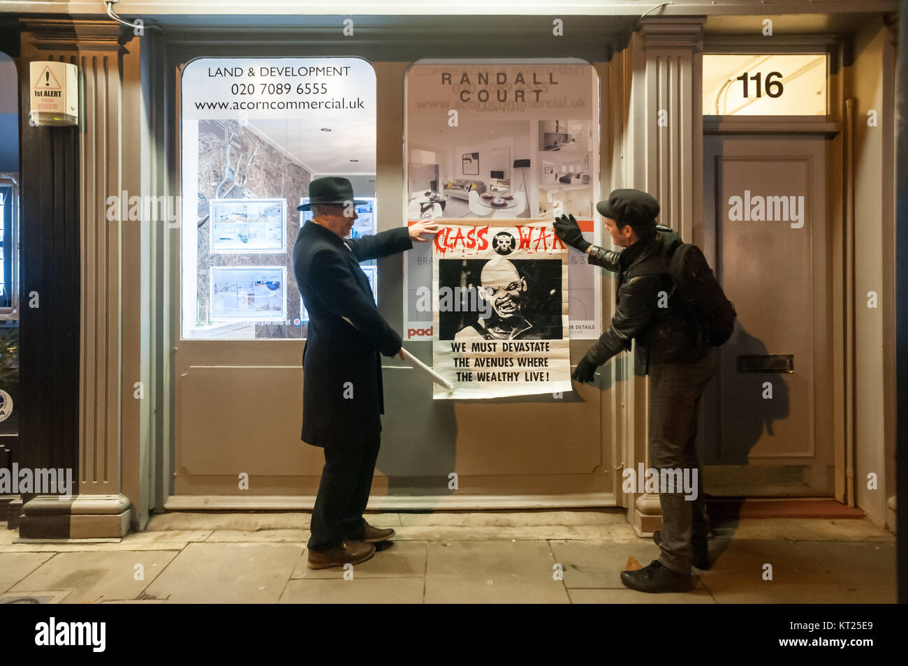 Ian Bone and Simon Elmer display the Class War poster 'We must devastate the avenues where the wealthly live' - Stock Image