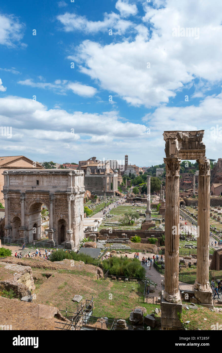 View from the Tabularium down Via Sacra with Arch of Septimius Severus to left and Temple of Vespasian and Titus - Stock Image