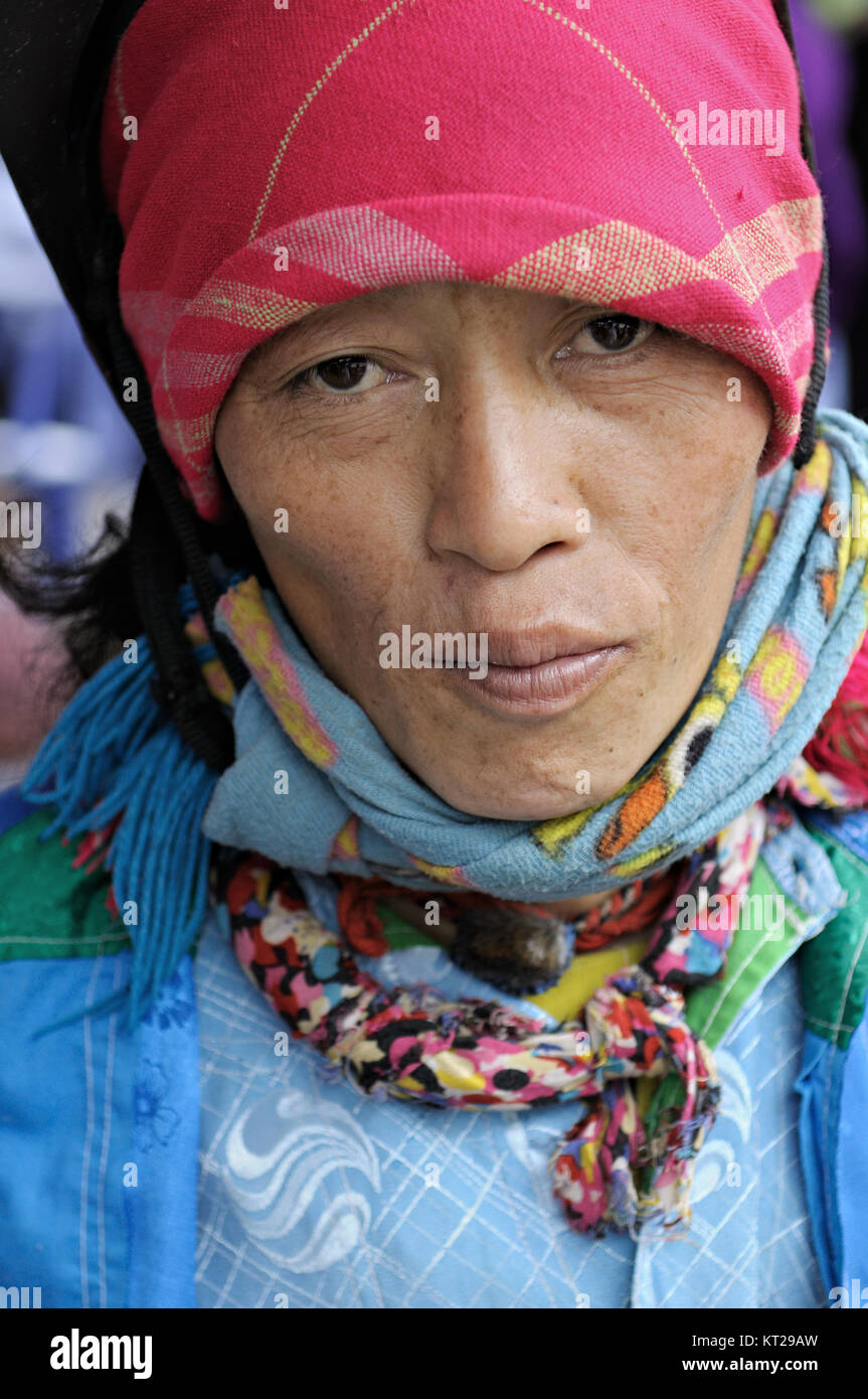 Portrait of a tribeswoman at Meo Vac market, Ha Giang Province, north Vietnam - Stock Image