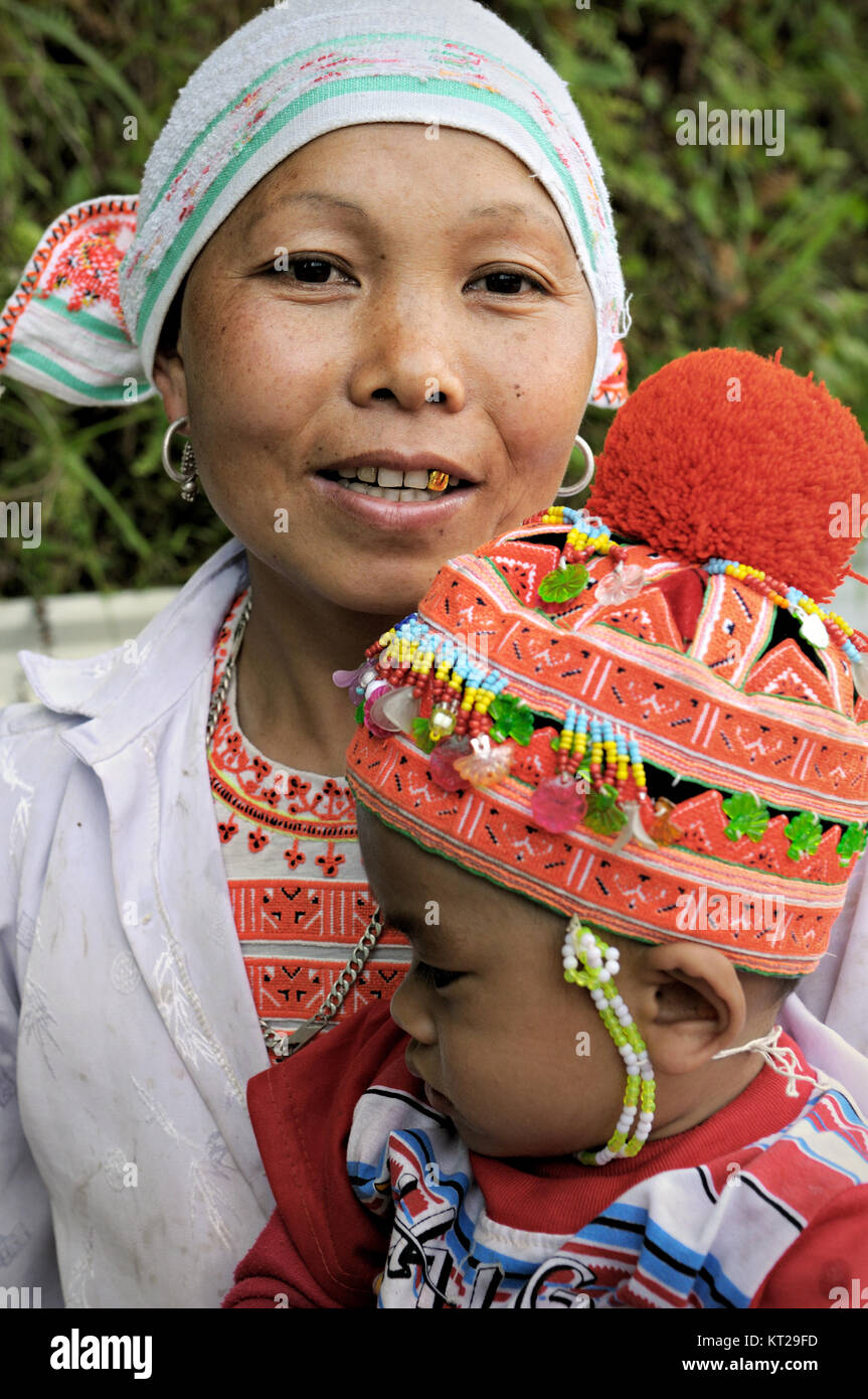 Portrait of a woman with a gold tooth and her baby in north Vietnam Stock Photo