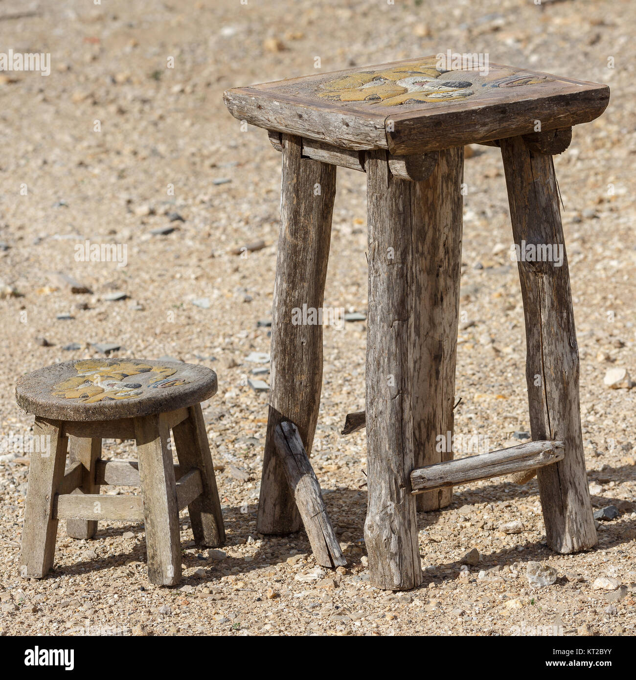 On the street there are two old, dilapidated chairs of handwork - Stock Image