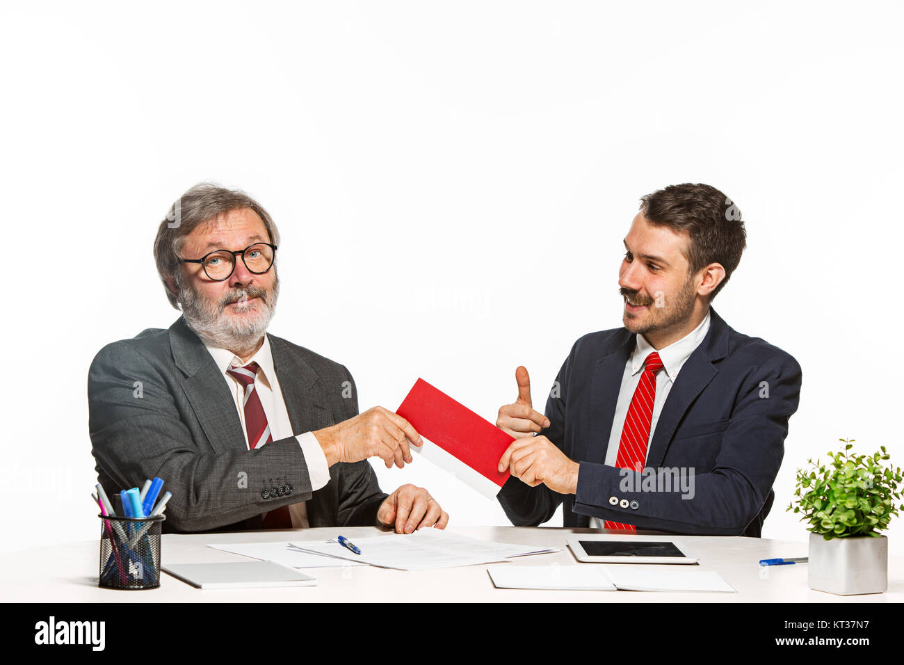 Concept - corruption. Businessman in a suit taking a bribe Stock Photo