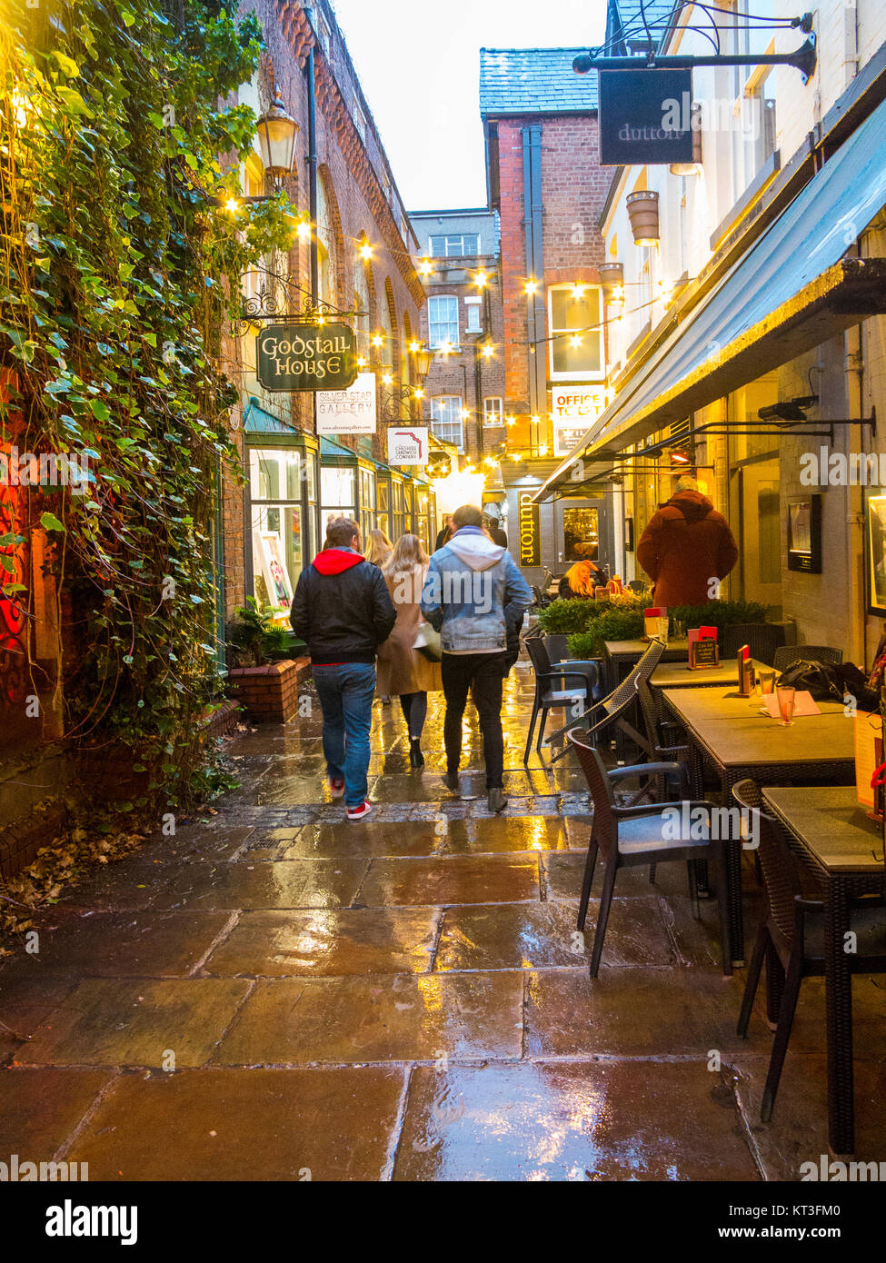 View along the wet pavements of the medieval godstall lane that links the city centre with the cathedral in the - Stock Image