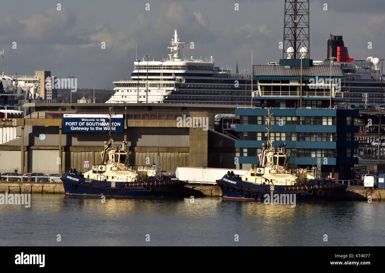 an ocean liner and some tug boats in the harbour at the port of Southampton docks in Hampshire, UK. Cruise liners - Stock Image