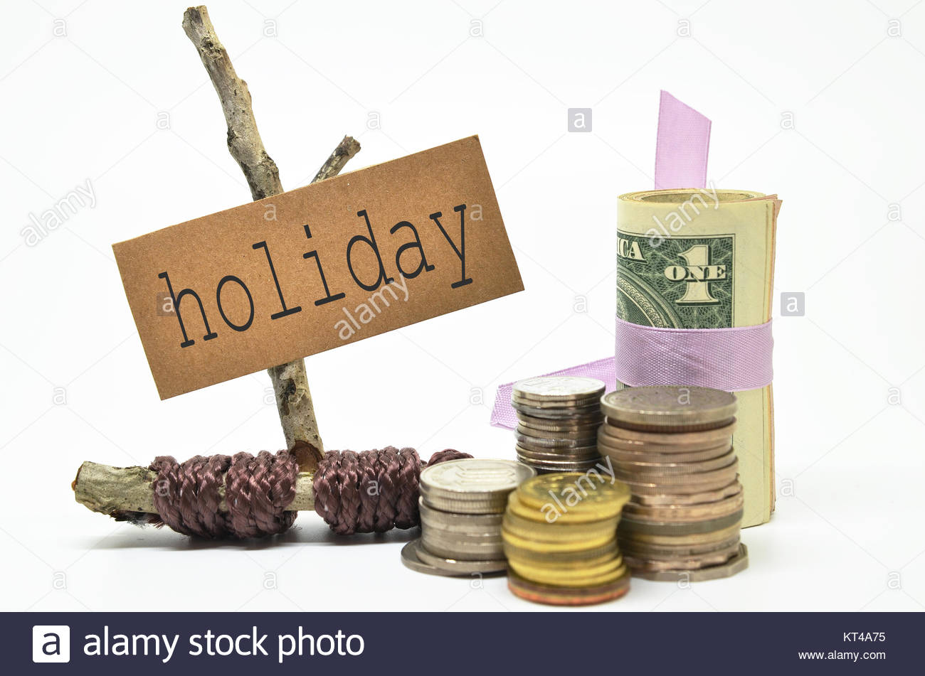 Coins and money with holiday label - Stock Image