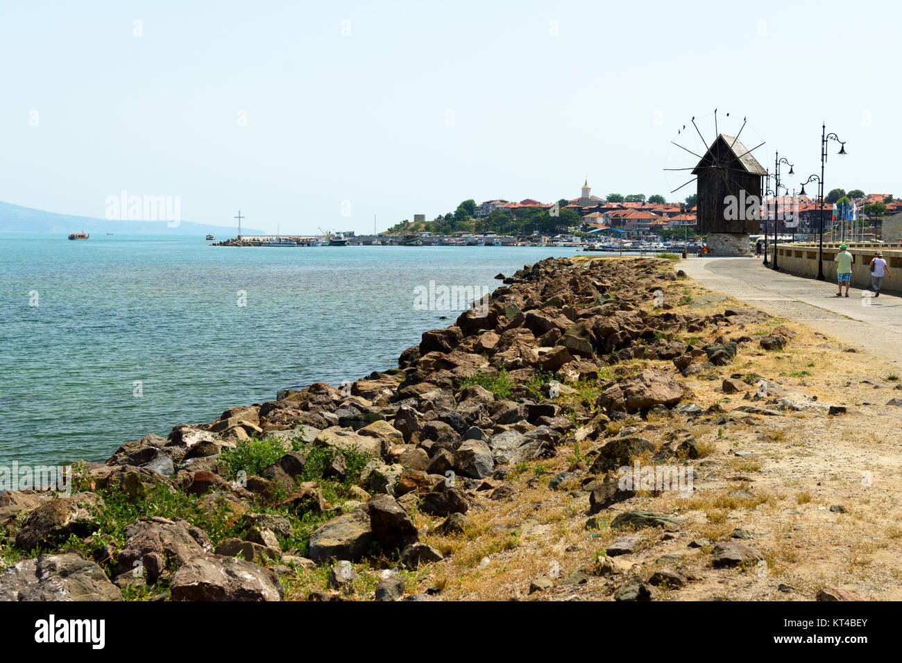 The wooden windmill on the isthmus of Nesebar connecting the mainland and the old town on the peninsula, Nesebar, - Stock Image