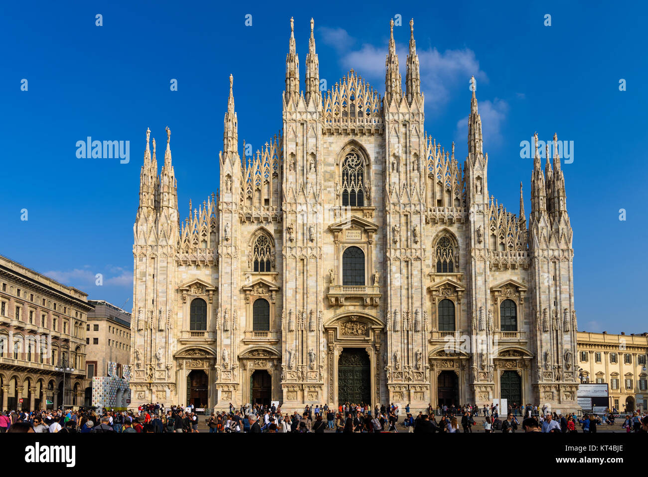 People at Duomo square in front of Milan Cathedral - the largest church in Italy, Milan, Lombardy - Stock Image