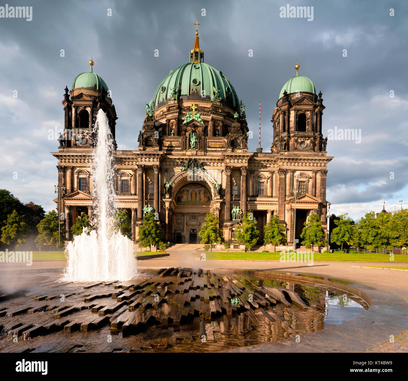 Berlin Cathedral, or Berliner Dom, with a fountain in front - Stock Image