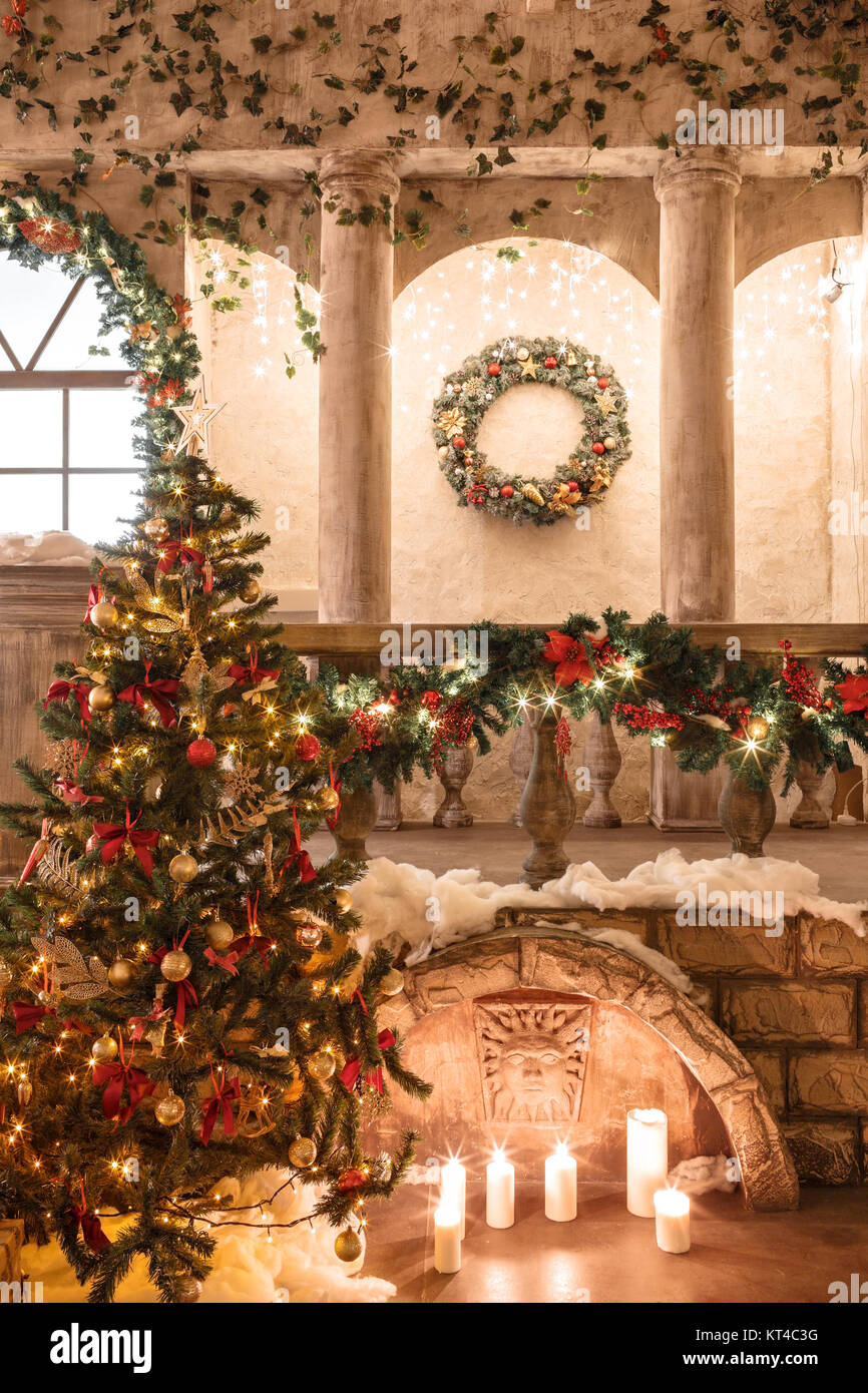 entrance in an old architecture with staircase and columns christmas decoration with garlands and fir branches