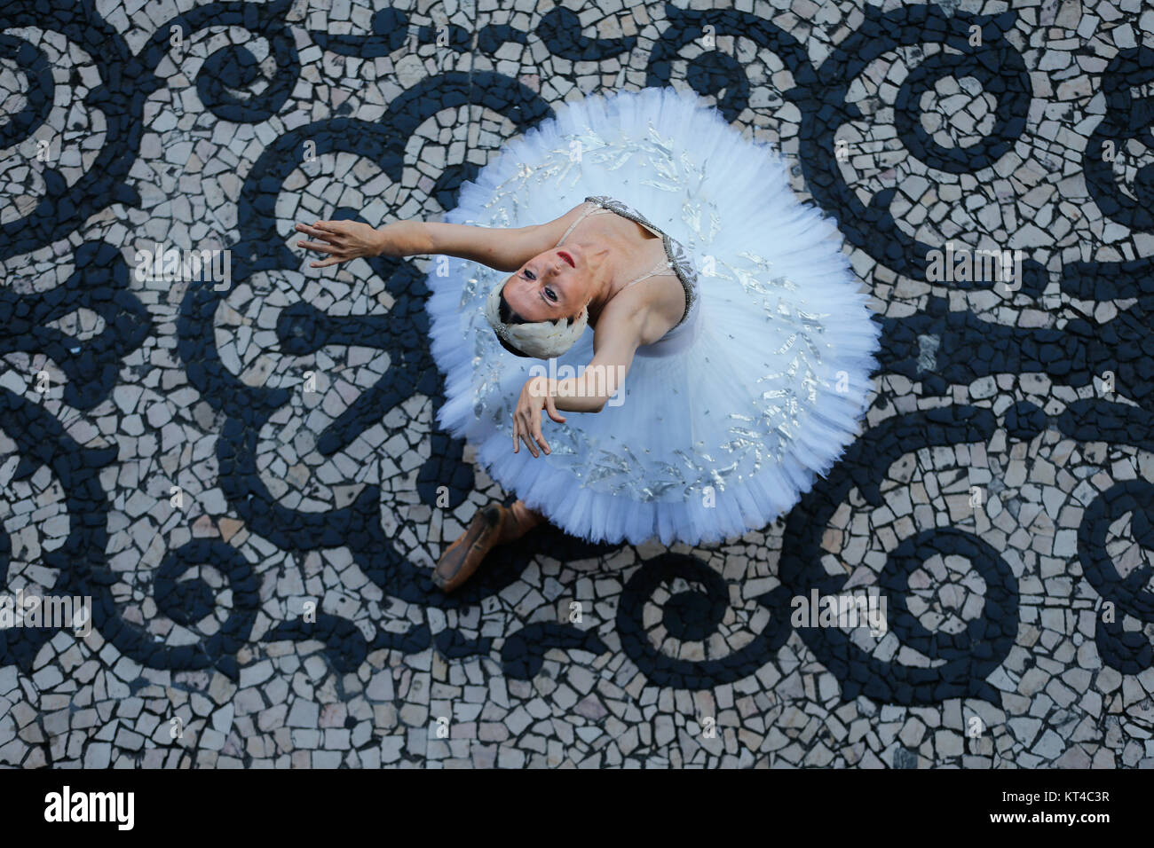 Ballerina Cecilia Kerche performs during a protest against government funding cuts to the arts and culture outside - Stock Image