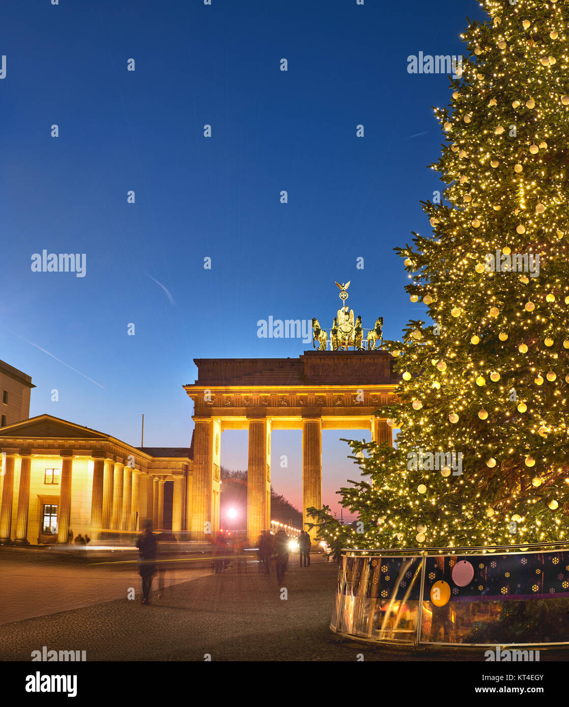 Brandenburger Gate in Berlin with Christmas tree at night with evening illumination, panoramic image - Stock Image