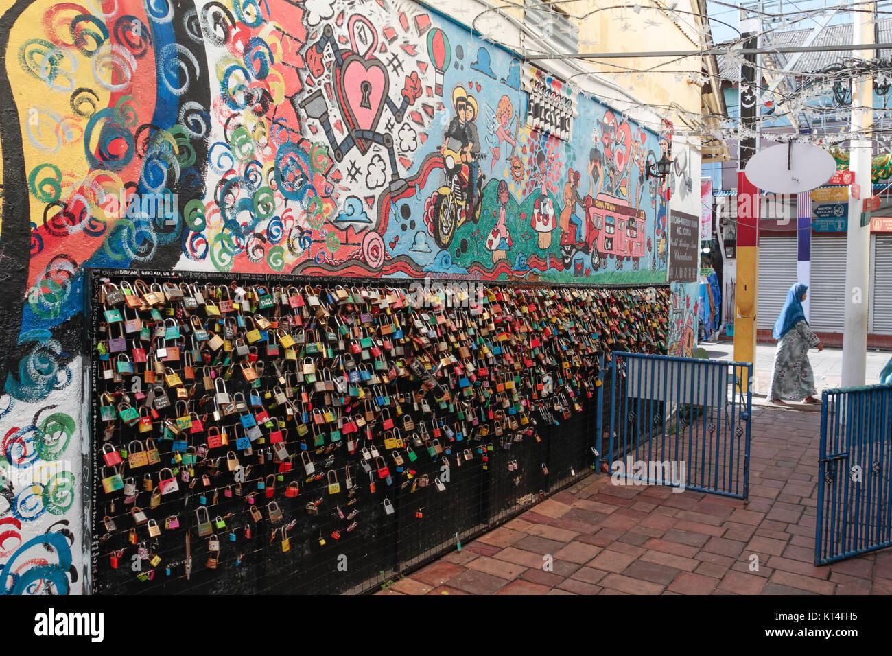 Padlocks and street art in Kuala Terengganu, Malaysia. - Stock Image