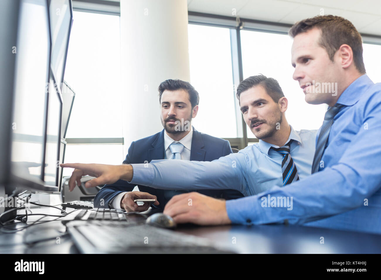 Business team working in corporate office. - Stock Image