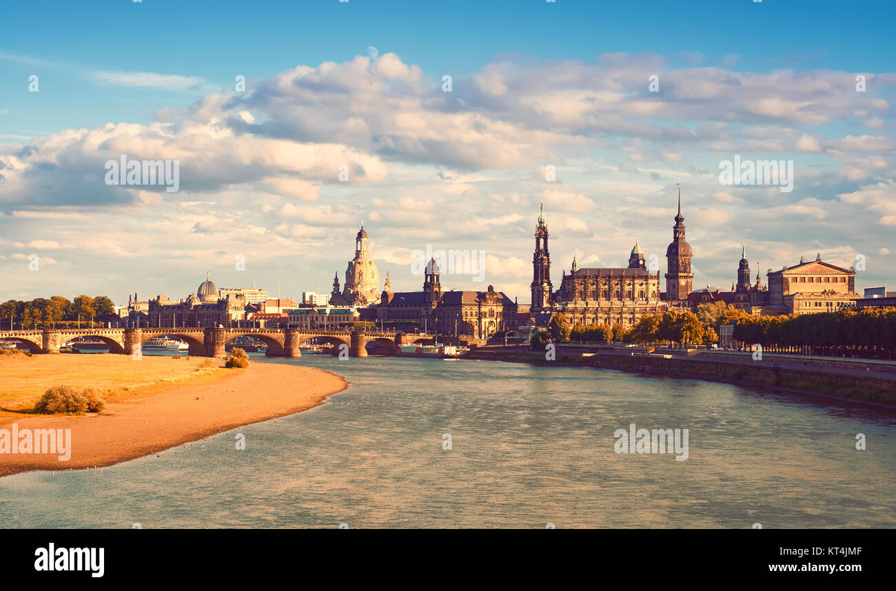 Panorama of Dresden Old Town with Frauenkirche, Hofkirche and Opera house from across the water in Autumn. Toned - Stock Image
