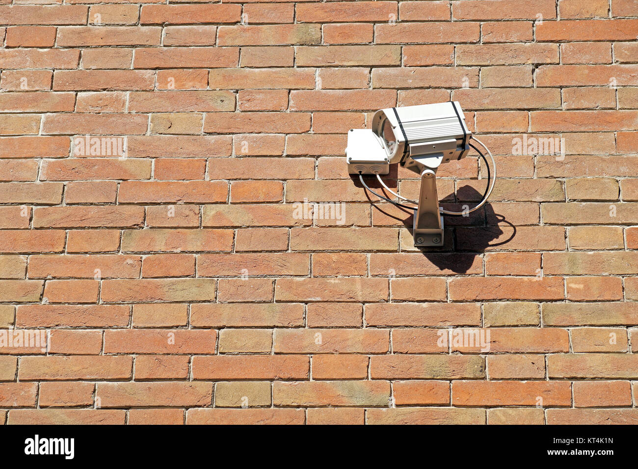cctv security camera. mounted on the brick wall outdoors. - Stock Image