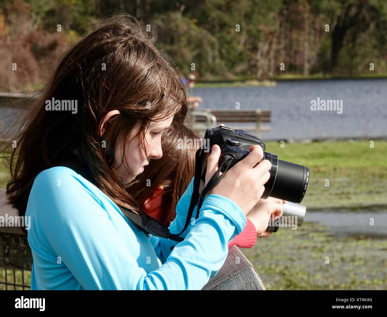Two young, elementary  school aged, girls learning to use cameras, taking photographs, at a state park. Gainesville, - Stock Image