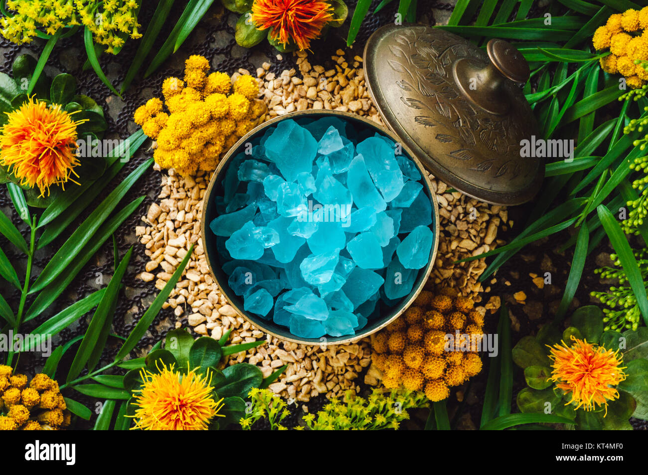 Brass Container with Blue Glass on Ginger Spill - Stock Image
