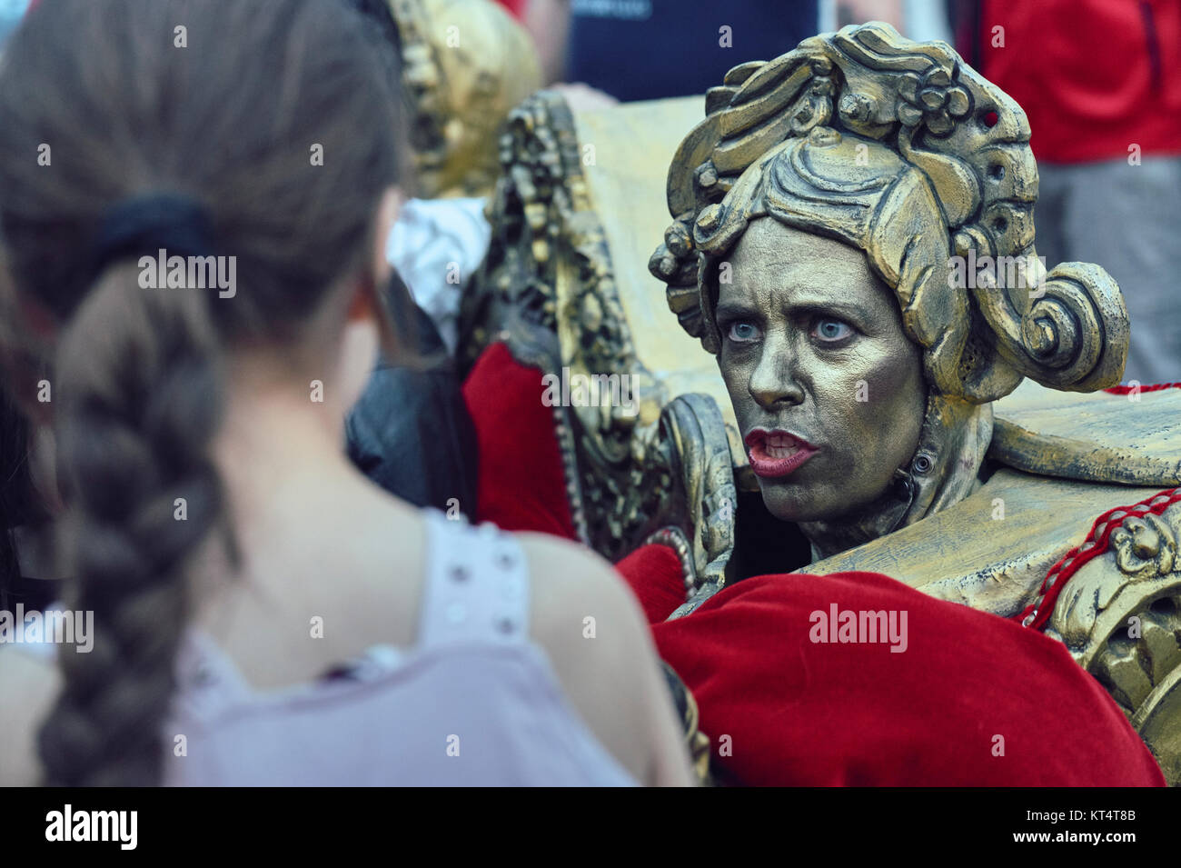 Bucharest, Romania - May 29, 2014: Actress acting as Baroque couch ornament interacts with people throughout The - Stock Image