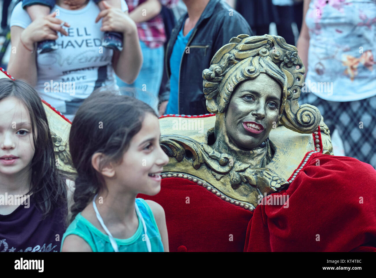 Bucharest, Romania - May 29, 2014: Actress acting as Baroque couch ornament entertains the children throughout The - Stock Image