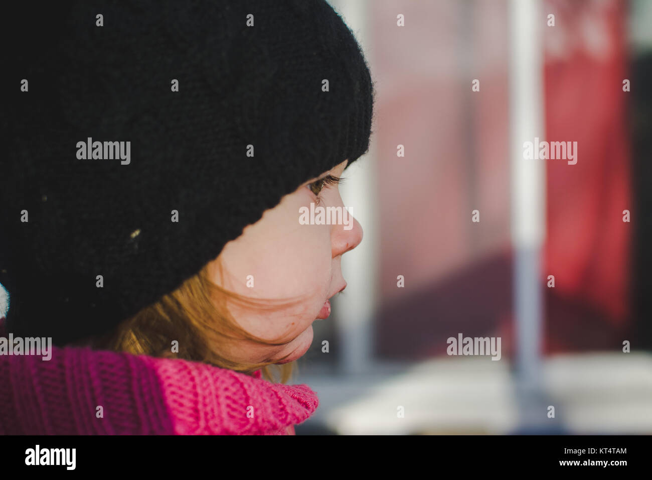 Close up of a toddler's face wearing a winter hat. Stock Photo