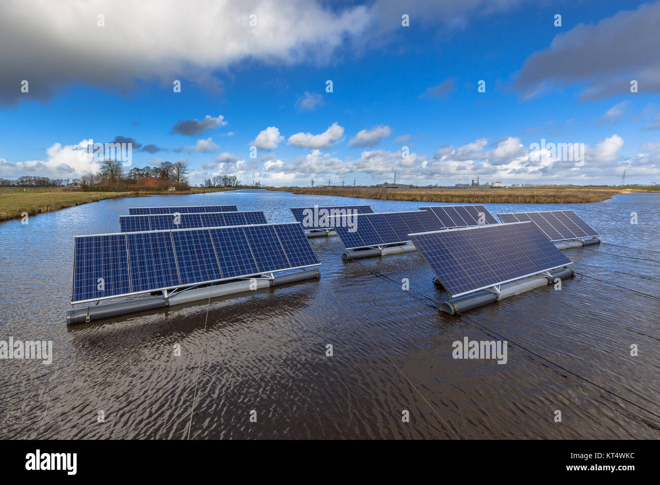 Group of photovoltaic panels floating on open water bodies can represent a serious alternative to ground mounted - Stock Image