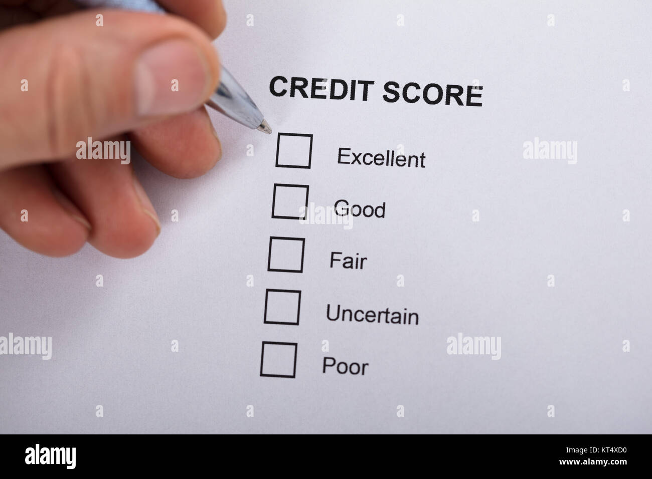 Person Filling Credit Score Form Stock Photo