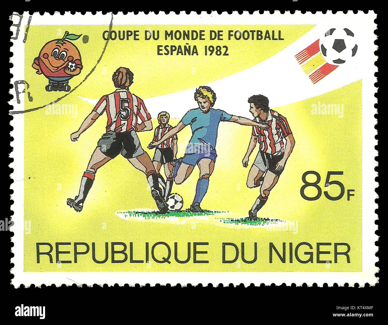 Niger - CIRCA 1981: Stamp on topic of Spain World Football Cup 1988, shows soccer player strikes the ball - Stock Image