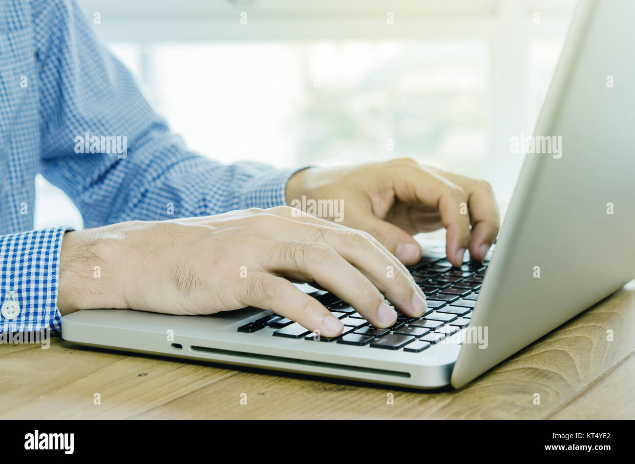 Close-up man hand using computer laptop in office. - Stock Image