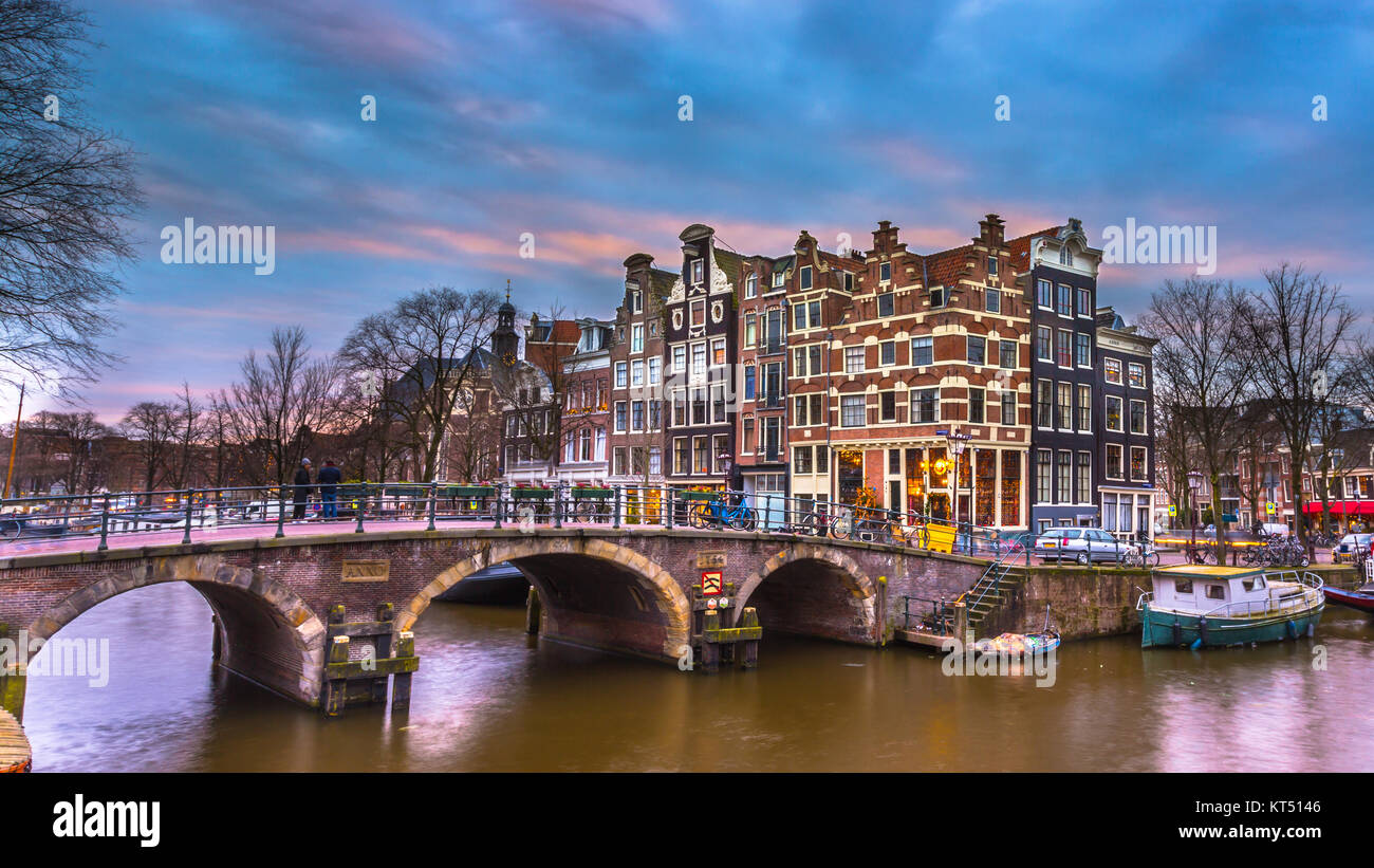 Colorful historic canal houses on the corner of brouwersgracht and Prinsengracht in the UNESCO World Heritage site - Stock Image