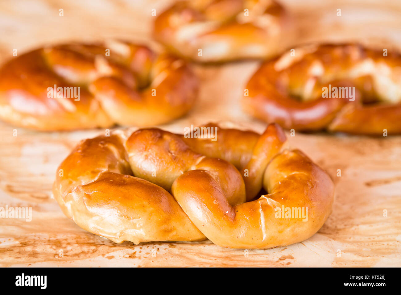 Cooked pretzel over the greaseproof paper - Stock Image