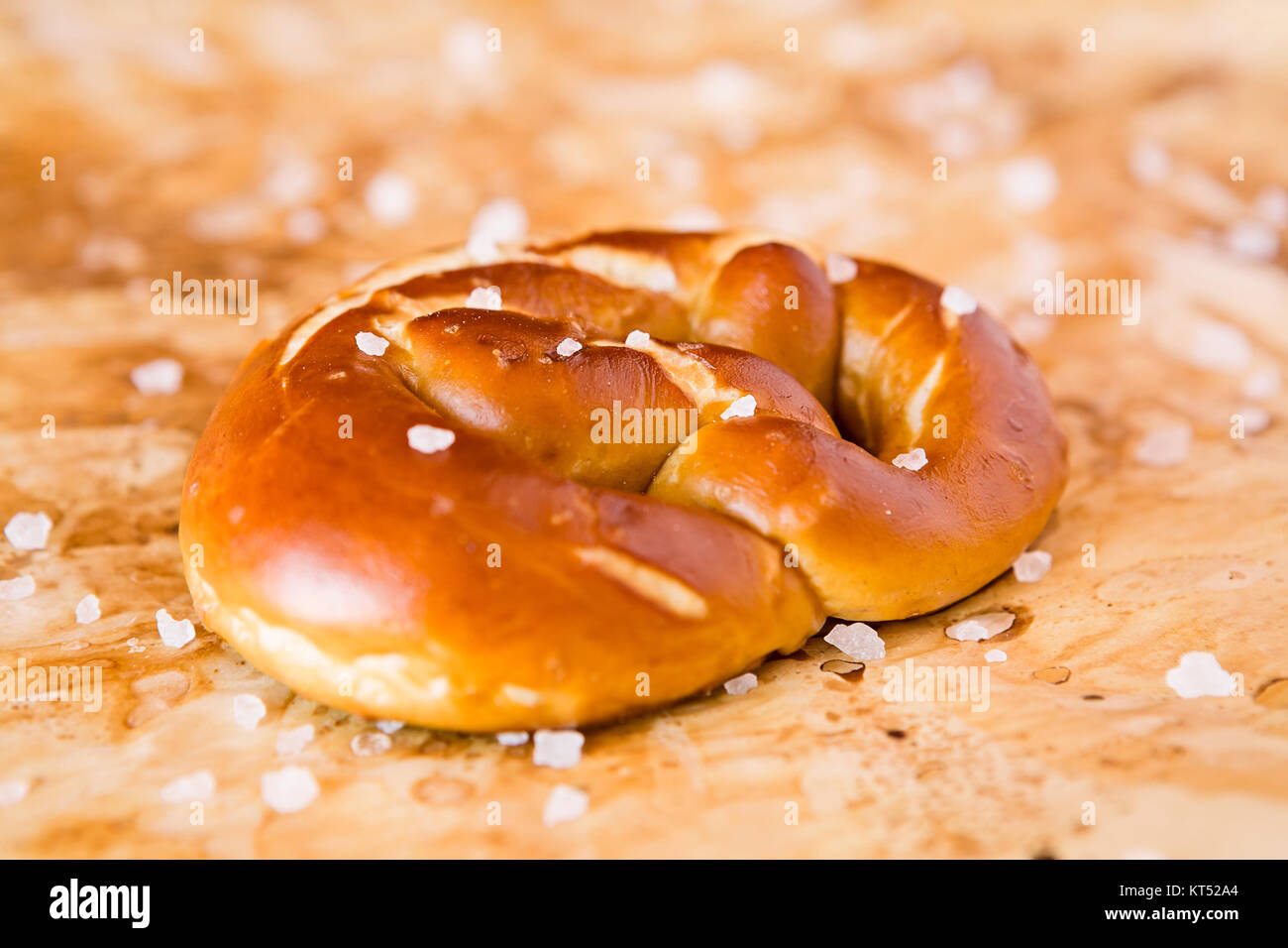 Closeup of salty cooked pretzel - Stock Image