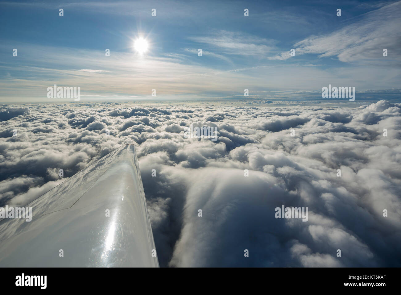 Clouds and sun, clouds flight over the northern NRW, clouds and blue sky, airfoil wing of an aircraft of general Stock Photo