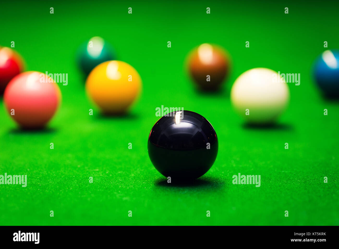 closeup of snooker balls on the green cloth table - Stock Image