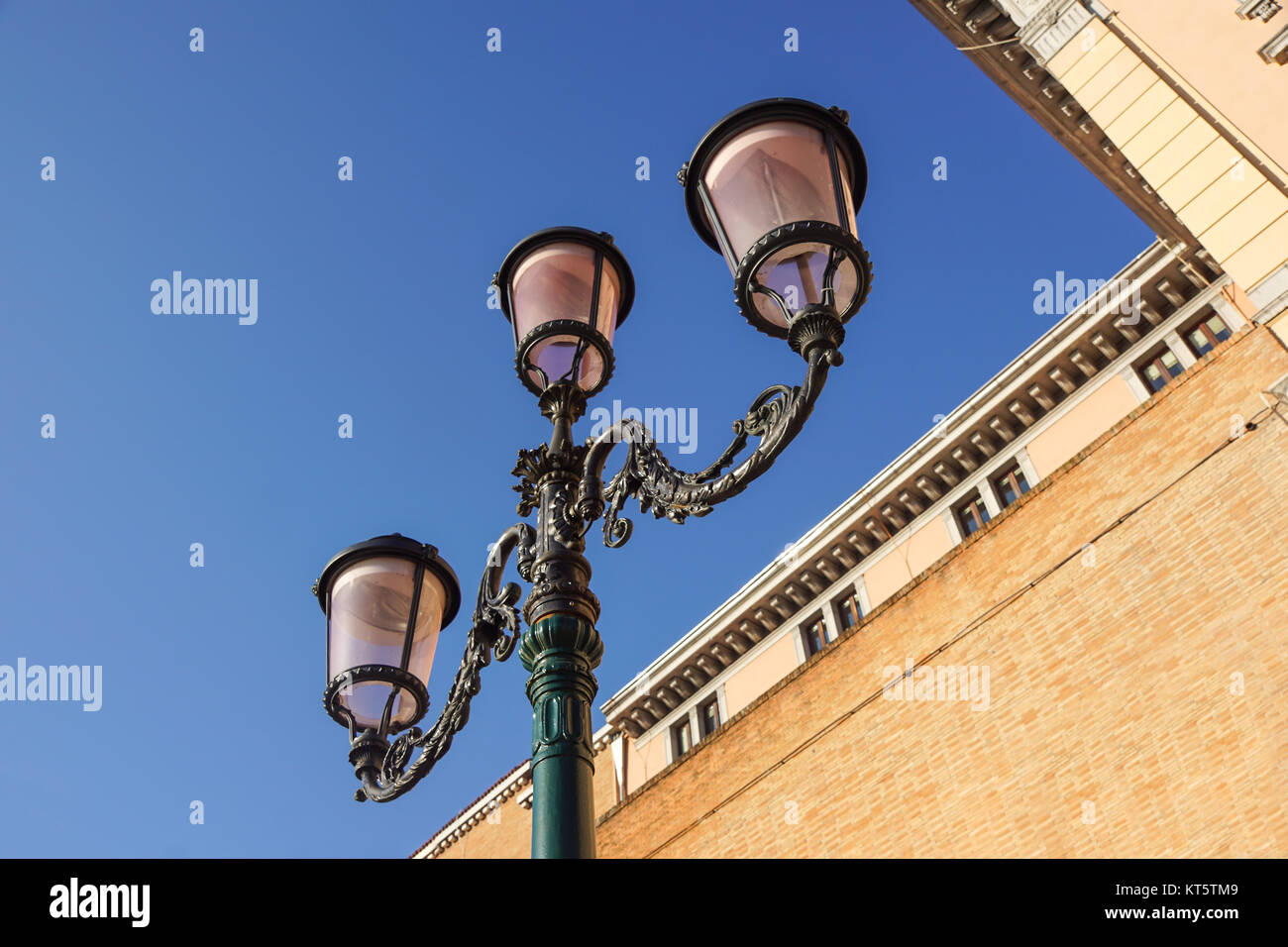 retro vintage street lamp isolated on sky background. Stock Photo