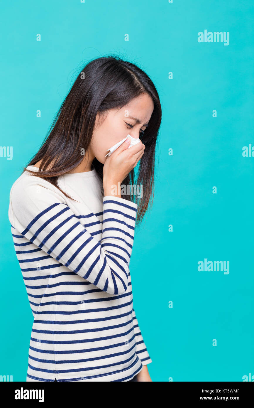 Asian Woman feeling unwell - Stock Image