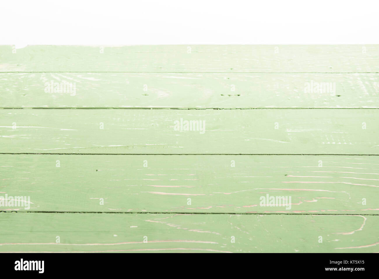 light green wooden background with horizontal planks on white - Stock Image