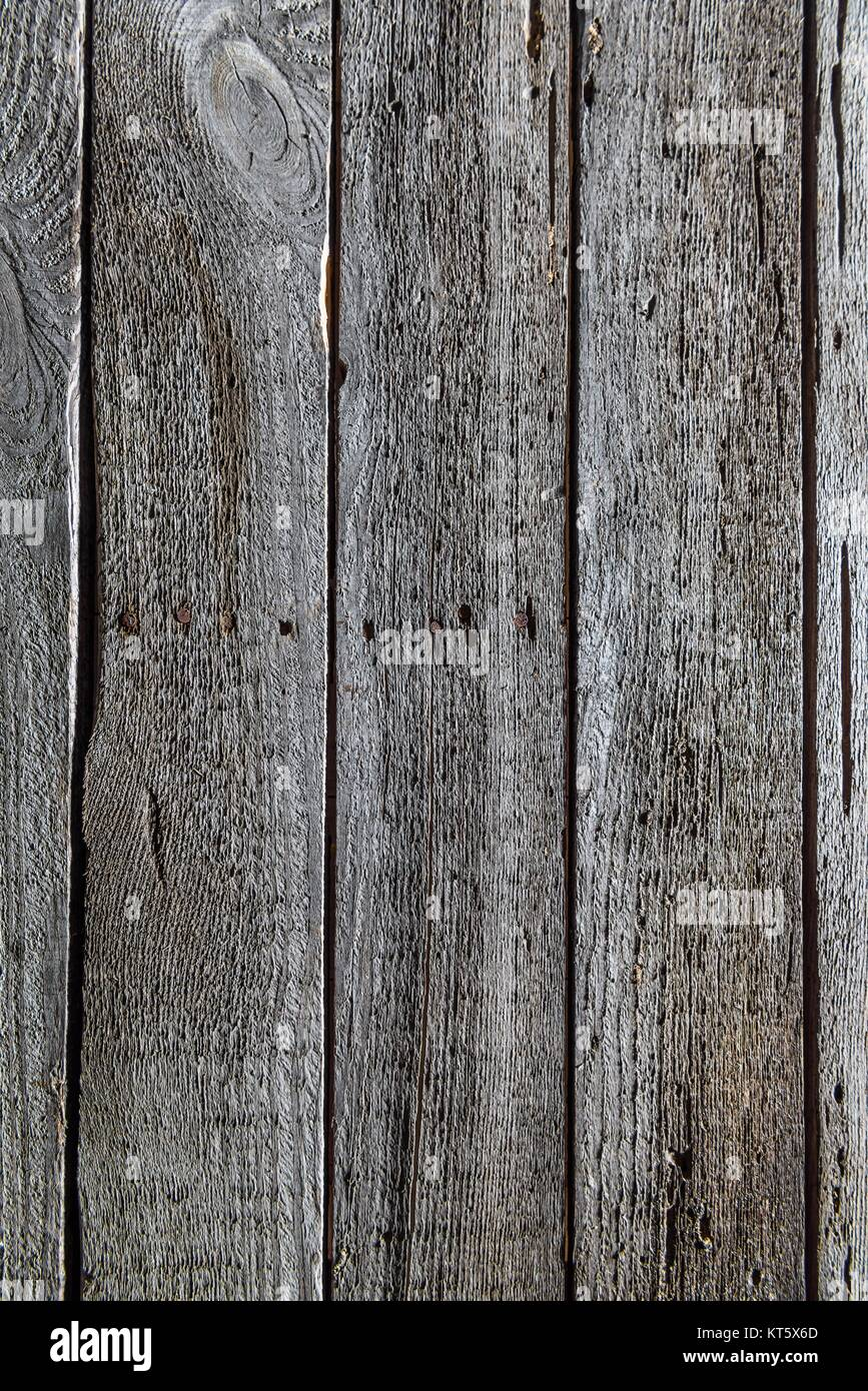 close up of dark wooden background with vertical planks - Stock Image