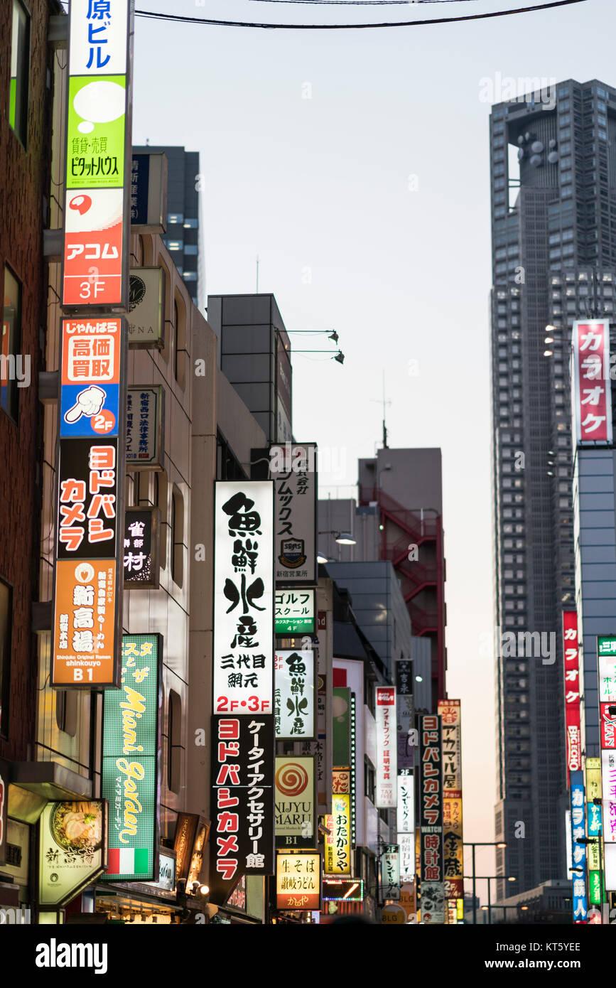 Colorful signs, sreet scene, Shinjuku Station west entrance area, Shinjuku, Tokyo, Japan - Stock Image