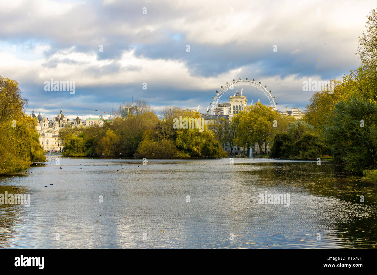 London skyline at Whitehall with the London Eye in the background. View from St James' Park in the City of Westminster. - Stock Image