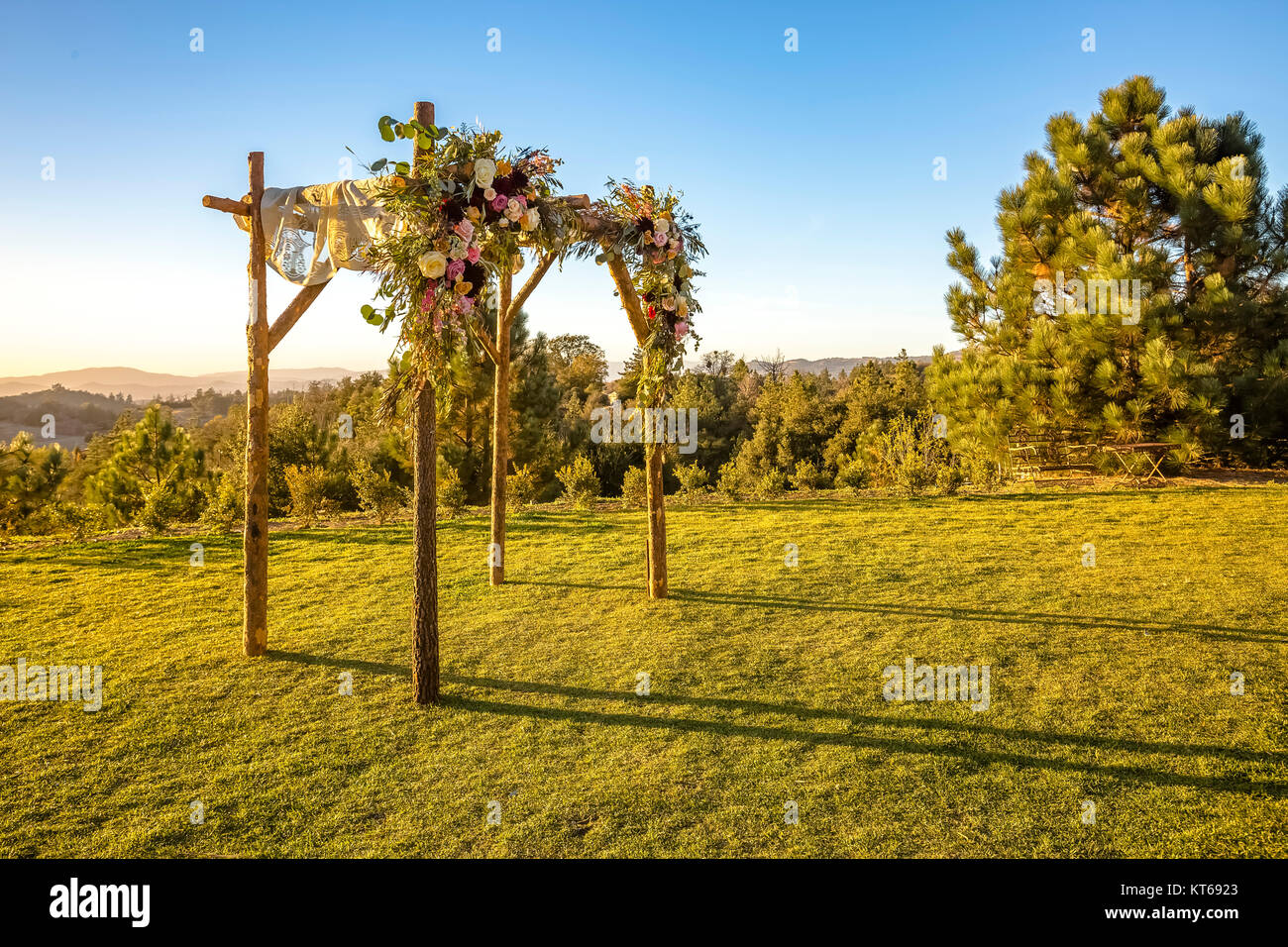 Jewish traditions wedding ceremony. Wedding canopy chuppah or huppah during golden hour Stock Photo