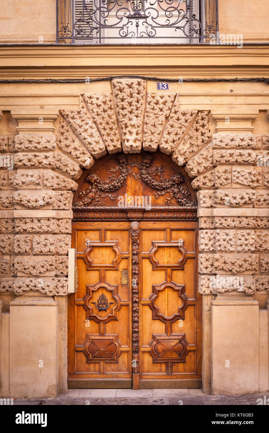 Wood doors at entry to building along Rue Aude in Aix-en-Provence, France - Stock Image