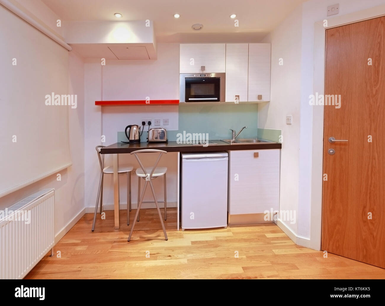 Small Modern Kitchen In Tiny Studio Apartment   Stock Image