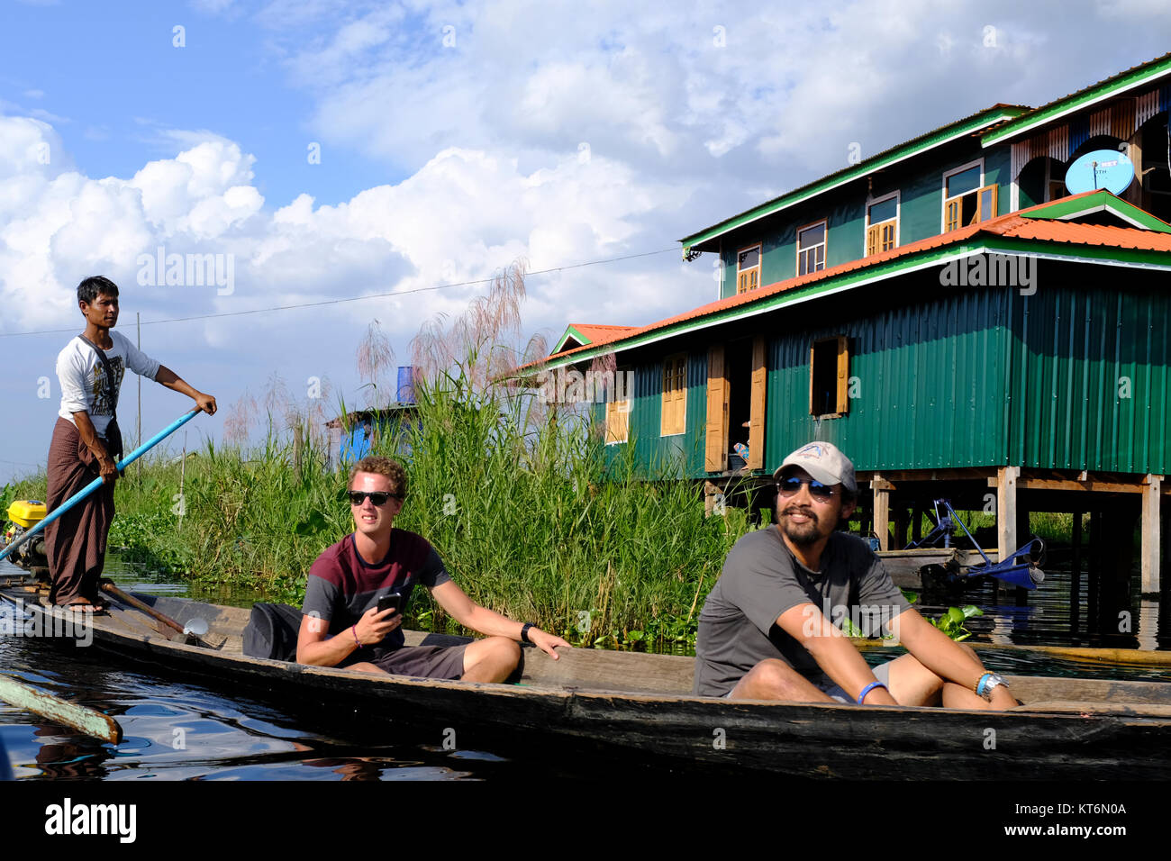Tourists on longboat in floating village on Inle Lake, Myanmar - Stock Image